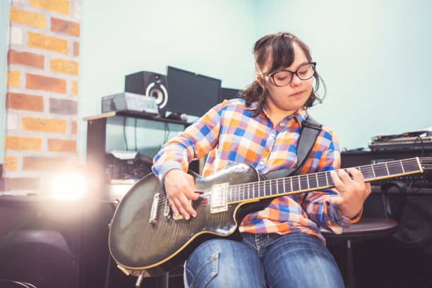 Who says that she can't play guitar stock photo