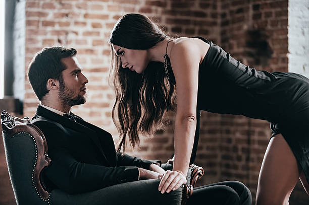 who set the rules? - man dominating woman stock photos and pictures