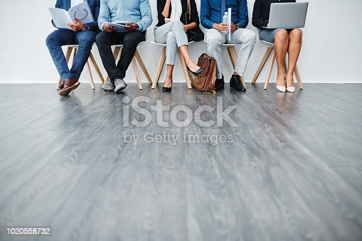 Cropped studio shot of a group of diverse businesspeople waiting in line