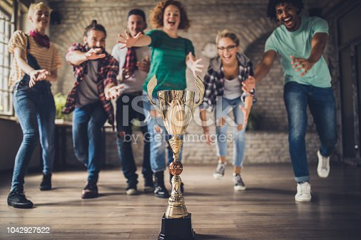 istock Who will get first to the trophy? 1042927522