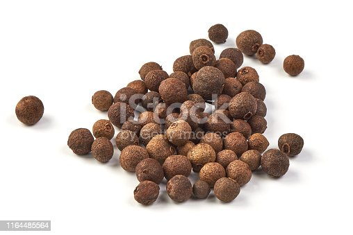 Whole allspice, isolated on white background. Aromatic allspice.