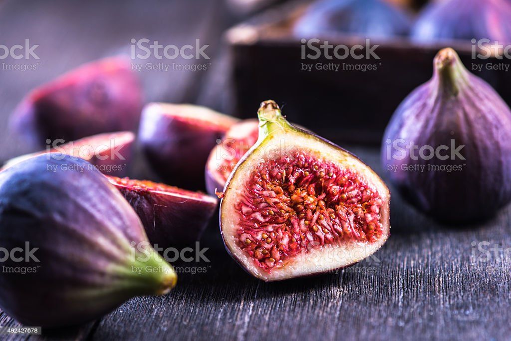 Whole and cut fresh vibrant figs fruit stock photo