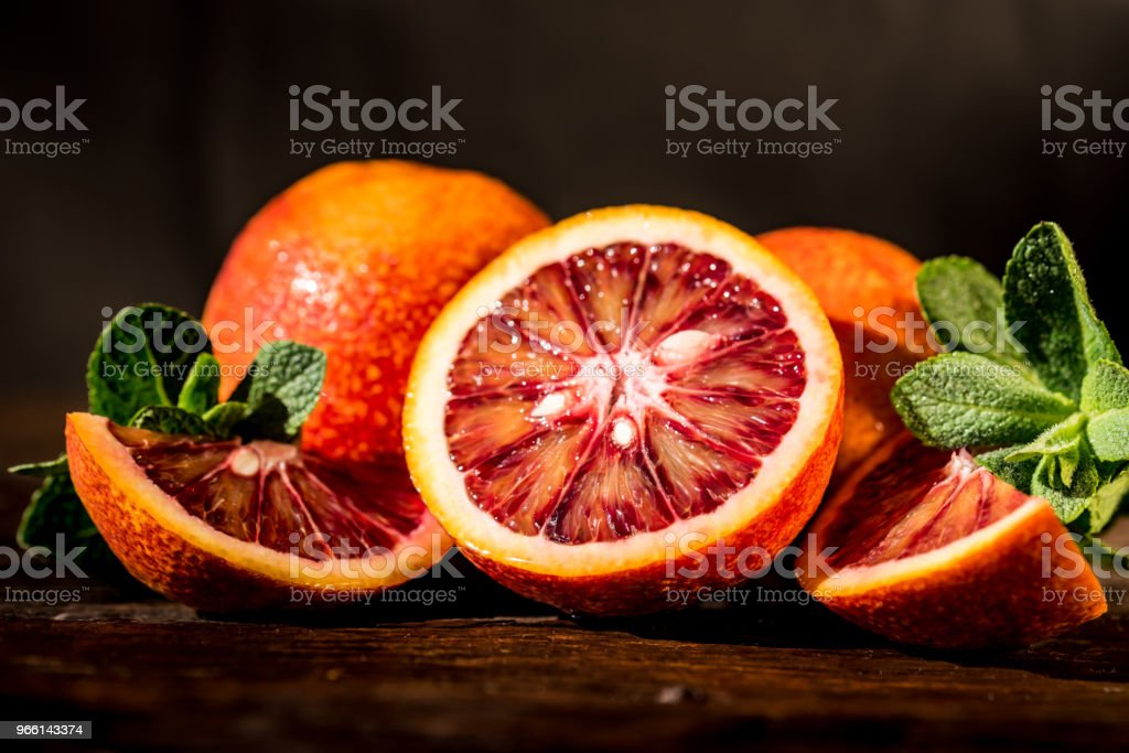 Whole and cut ripe juicy Sicilian Blood oranges - Royalty-free Alcohol Stock Photo