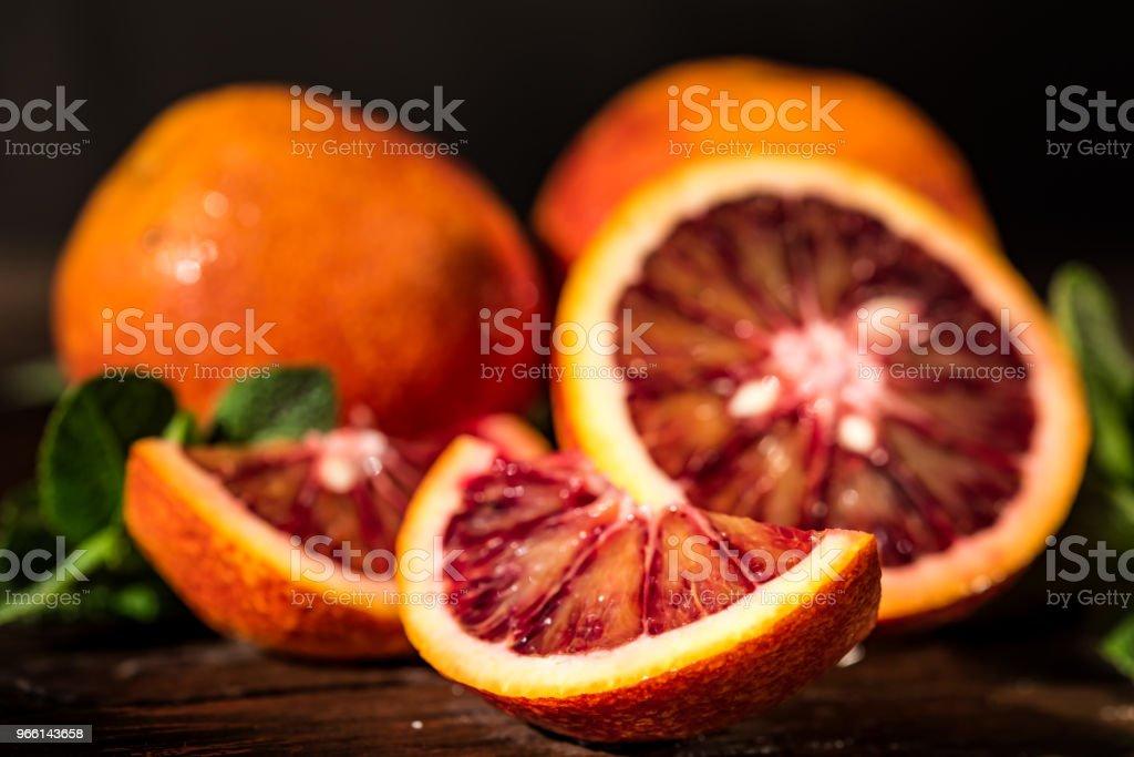 Whole and cut ripe juicy Sicilian Blood oranges - Royalty-free Amarelo Foto de stock