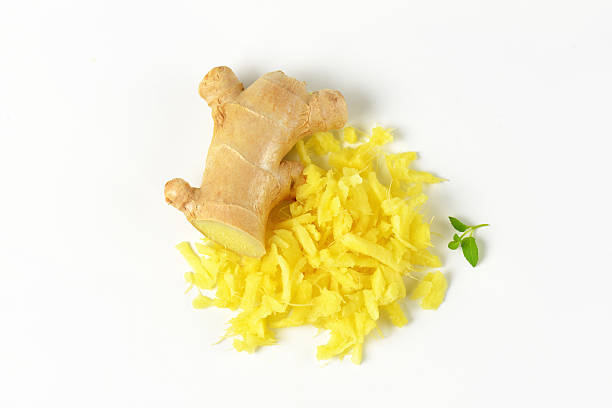 whole and grated ginger root stock photo