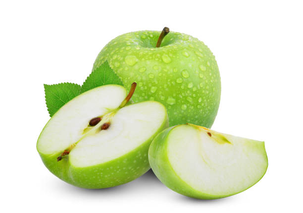 whole and hafl with slice of green apple or granny smith apple with green leaves isloated on white background whole and hafl with slice of green apple or granny smith apple with green leaves isloated on white background granny smith apple stock pictures, royalty-free photos & images