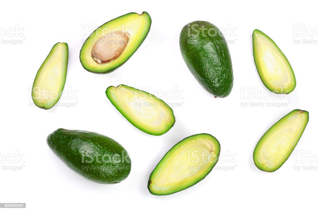 whole and half avocado isolated on white background close-up. Top view stock photo
