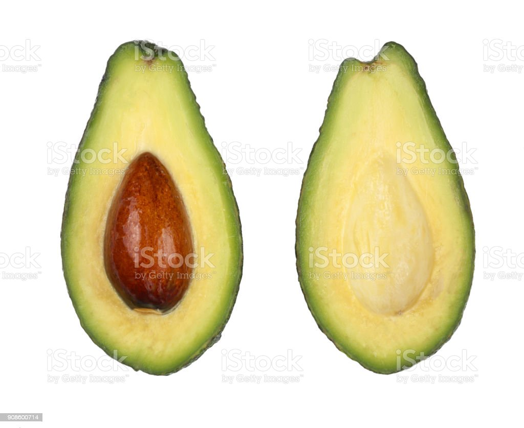 whole and half avocado isolated on white background close-up. Top view. Flat lay pattern stock photo