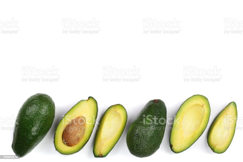 whole and half avocado isolated on white background with copy space for your text. Top view. Flat lay stock photo