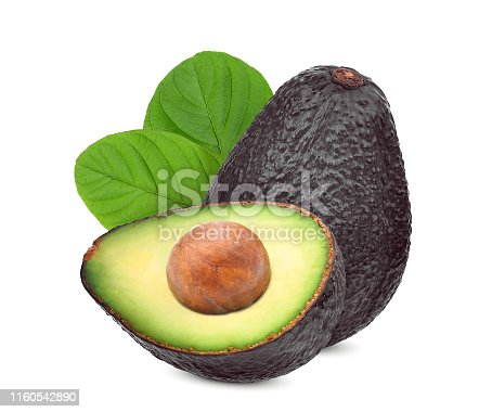 whole and half avocado with green leaf isolated on white background