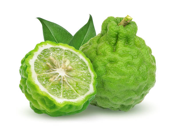 whole and half bergamot fruit with leaf isolated on white background – zdjęcie