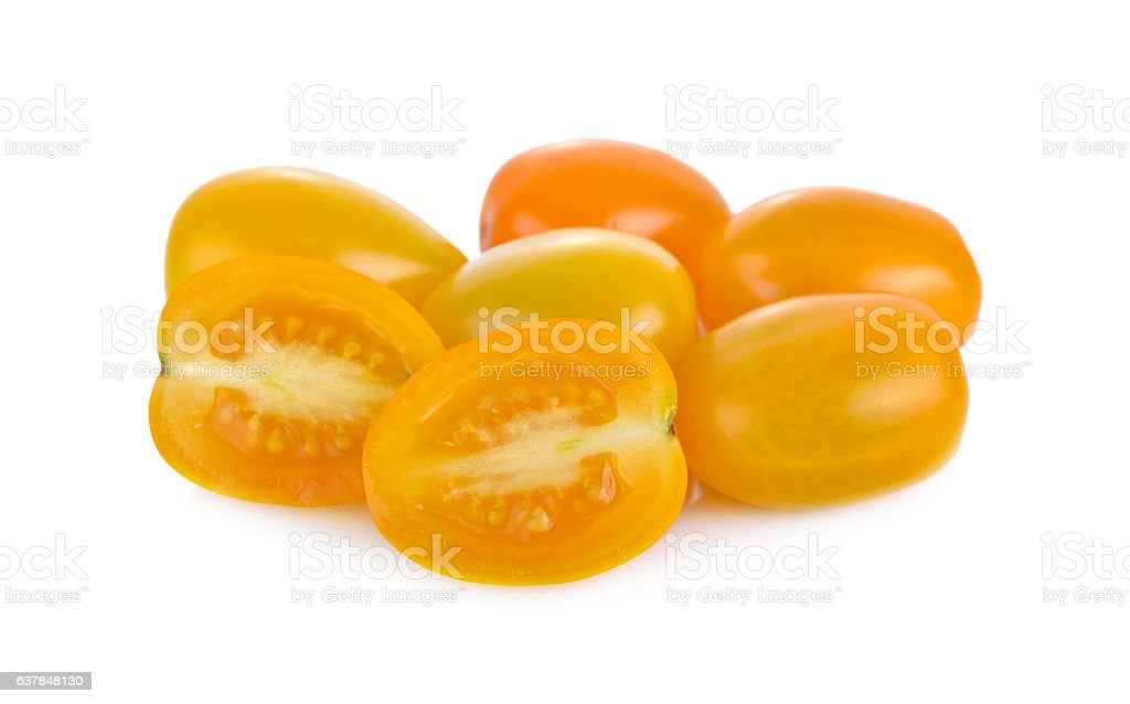 whole and half cut yellow cherry tomato on white background stock photo