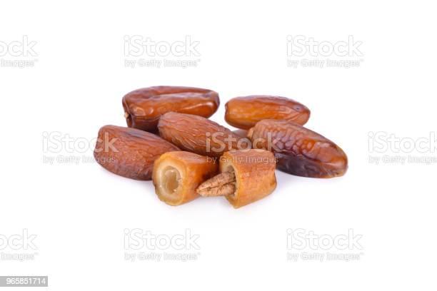 Whole And Half Date Fruit With Seed On White Background - Fotografias de stock e mais imagens de Alimentação Saudável
