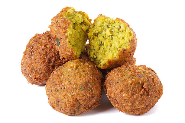 whole and half falafel isolated on a white background stock photo