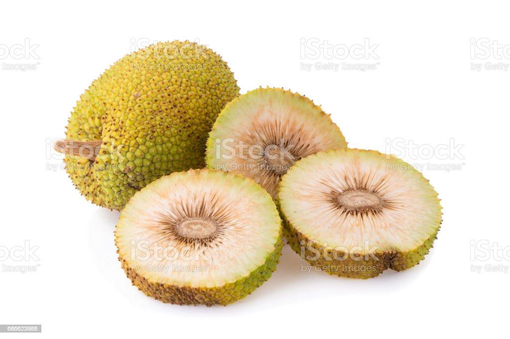 Whole and half fresh breadfruit on white background royalty-free stock photo
