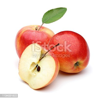 Whole and half gala apples with leaf isolated on white background