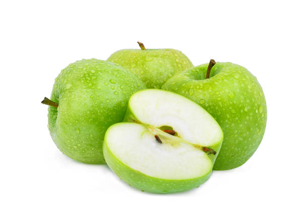 whole and half green apple or granny smith apple with drop of water isloated on white background whole and half green apple or granny smith apple with drop of water isloated on white background granny smith apple stock pictures, royalty-free photos & images