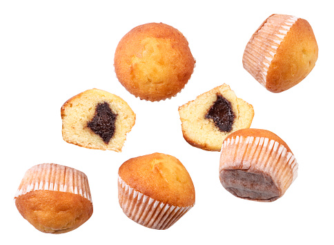 Whole and half muffins fly close-up on a white background. Isolated