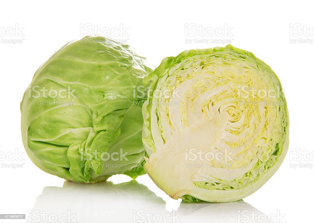 Whole and half of cabbage stock photo