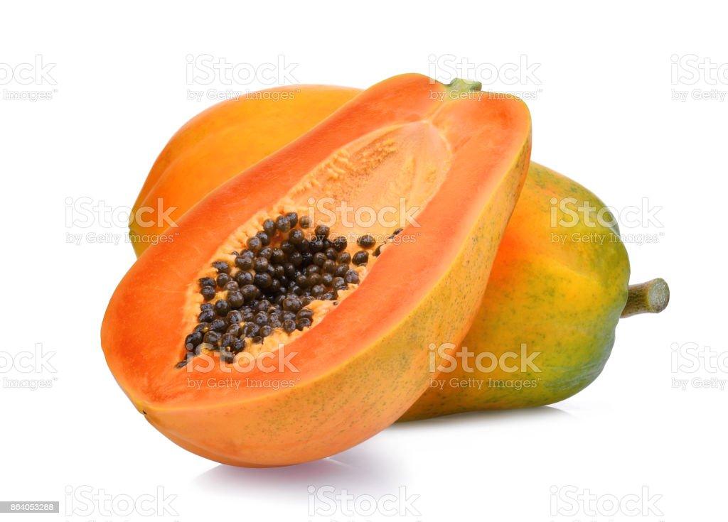 whole and half of ripe papaya fruit with seeds isolated on white background stock photo
