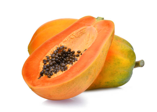 whole and half of ripe papaya fruit with seeds isolated on white background - maturo foto e immagini stock