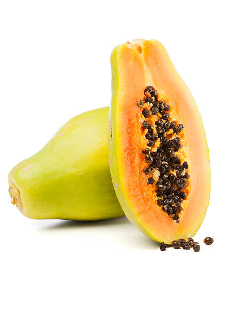 Whole and half Papaya fruit isolated stock photo