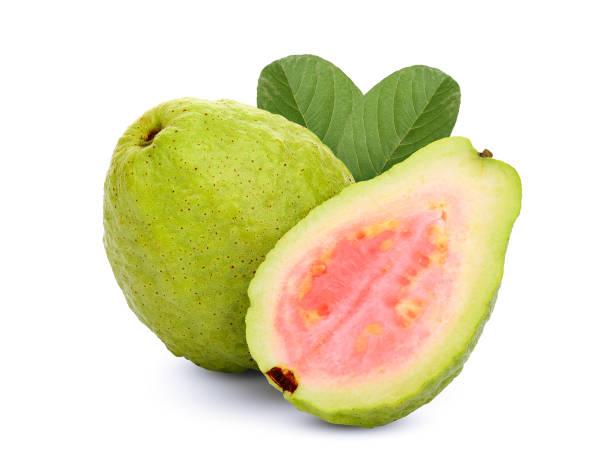 whole and half pink guava with leaf isolated on white background whole and half pink guava with leaf isolated on white background guava stock pictures, royalty-free photos & images