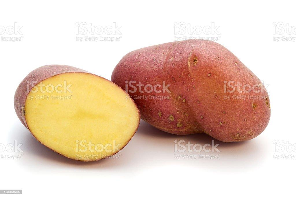 whole and half red miniature potato stock photo