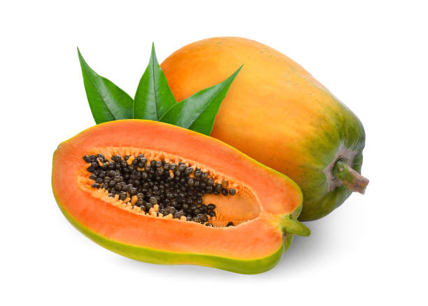 whole and half ripe papaya with green leaves isolated on white background – zdjęcie