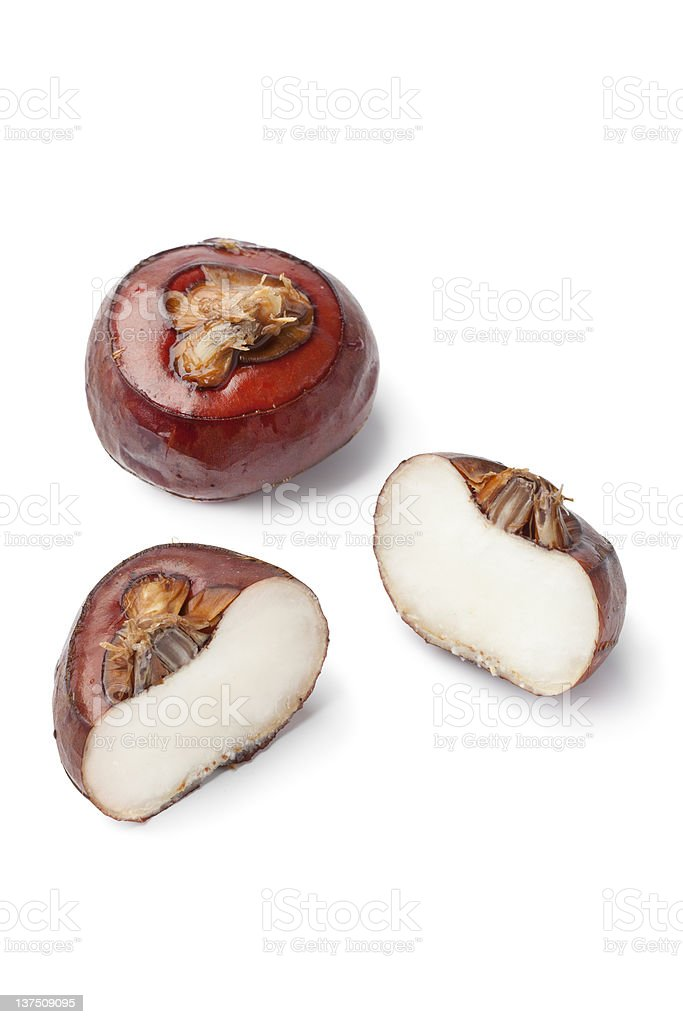 Whole and half water chestnuts stock photo