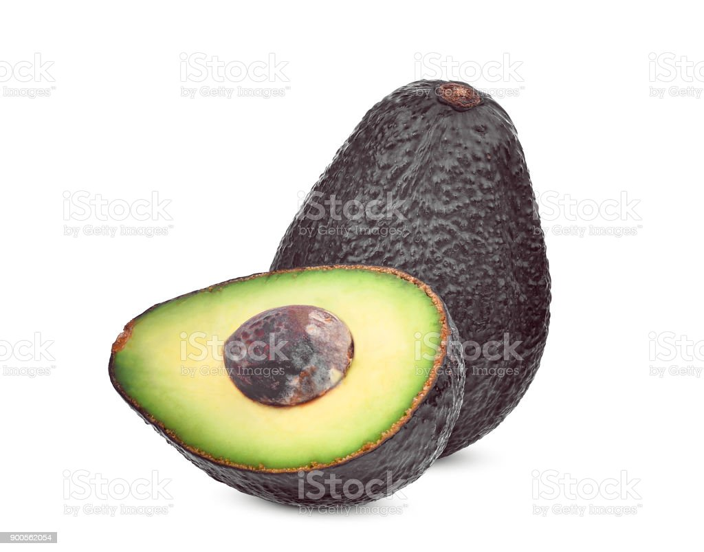 whole and half with seed of avocado isolated on white background stock photo