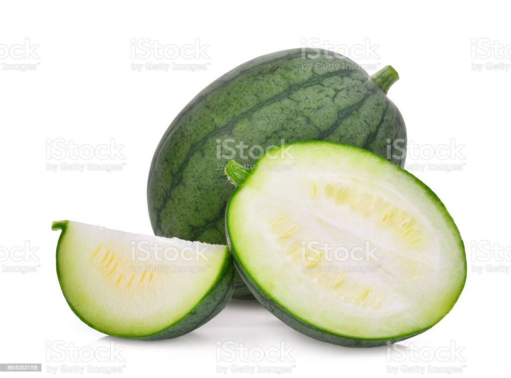 whole and half with slice of young small green watermelon isolated on white background stock photo