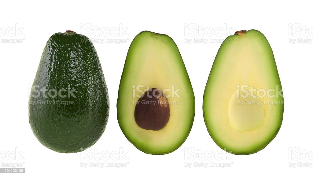 A whole and halved avocado on white stock photo