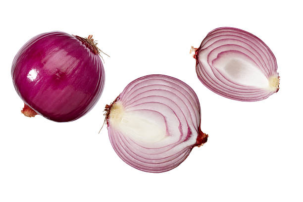 Whole and halves of red onions on white background Red onion on a white background spanish onion stock pictures, royalty-free photos & images