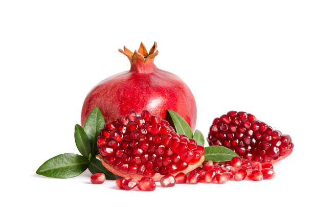 whole and part of pomegranate with leaves isolated on white - romã imagens e fotografias de stock