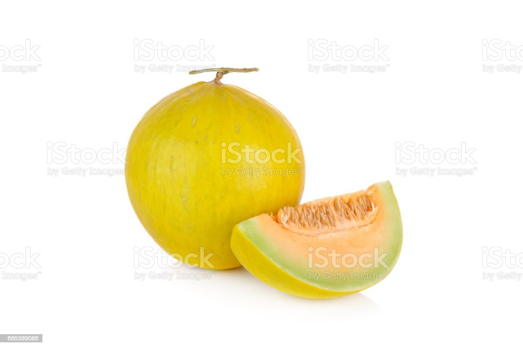 whole and portion cut fresh yellow melon with stem on white background foto de stock royalty-free