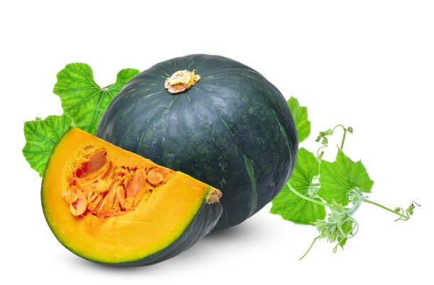 whole and slice green pumpkin with leaf isolated on white background – zdjęcie