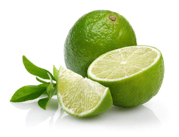 Whole and slice of lime with leaves Whole and slice of lime with leaves isolated on white background lime stock pictures, royalty-free photos & images