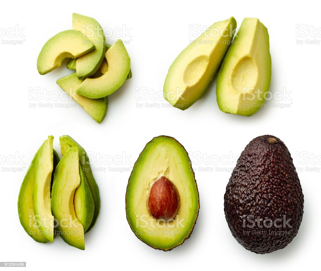 Whole and sliced avocado stock photo