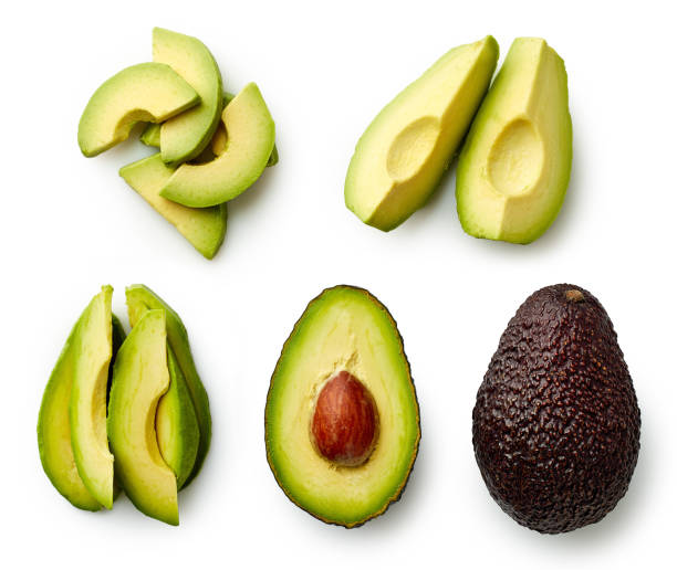 whole and sliced avocado - ripe stock photos and pictures