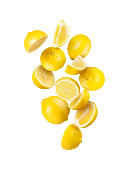 Whole and sliced fresh lemon in the air isolated on white stock photo