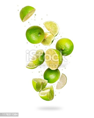 istock Whole and sliced fresh lime in the air, isolated on a white background 1176311384