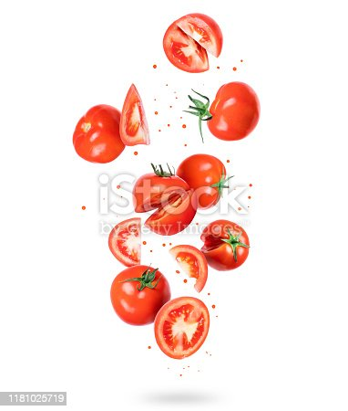 istock Whole and sliced fresh tomatoes in the air, isolated on a white background 1181025719