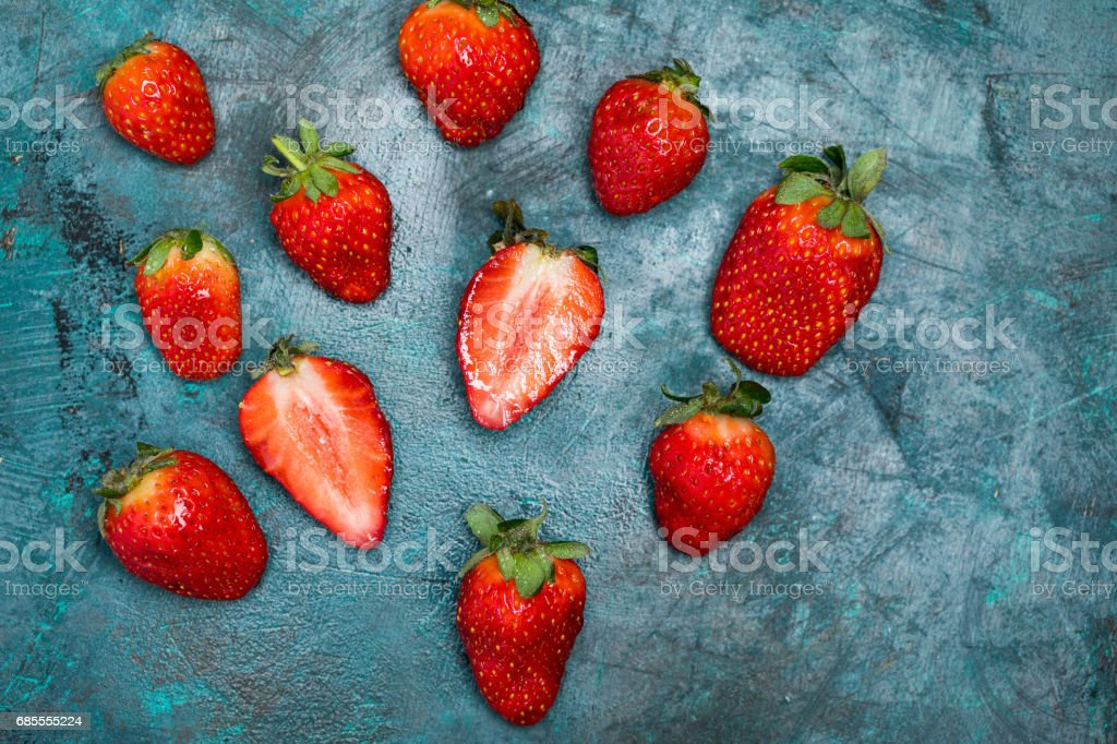 whole and sliced ripe red strawberries on tabletop 免版稅 stock photo