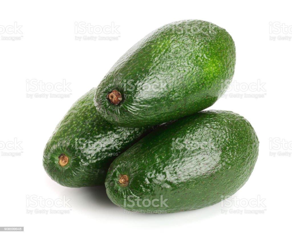 whole avocado isolated on white background close-up stock photo