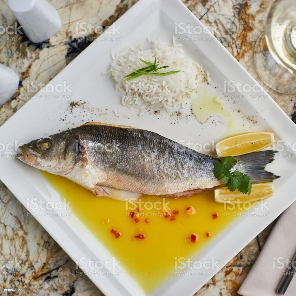 Whole boiled wolffish on plate royalty-free stock photo