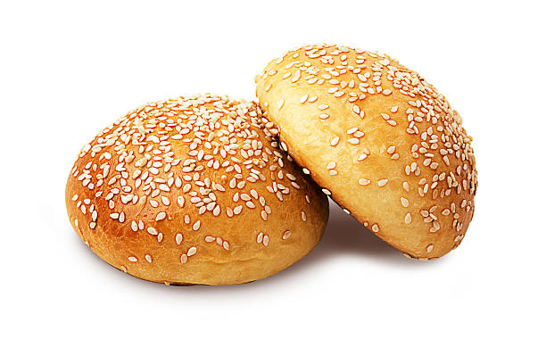 Whole buns Two whole buns with sesame seeds isolated on white sweet bun stock pictures, royalty-free photos & images