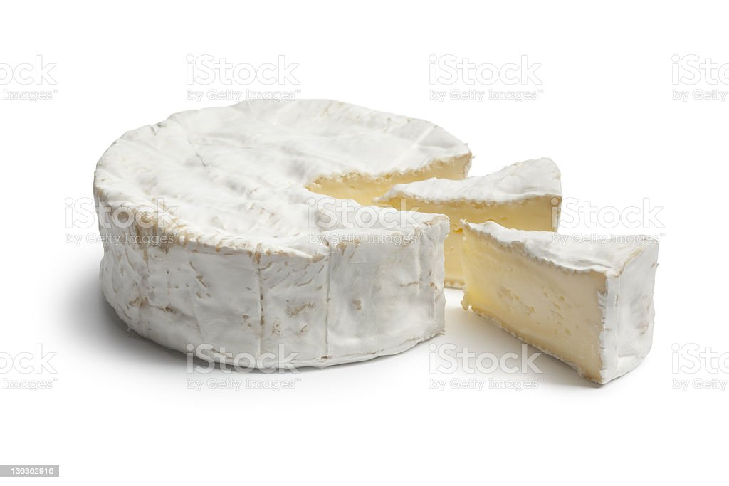 Whole Camembert cheese and portions stock photo