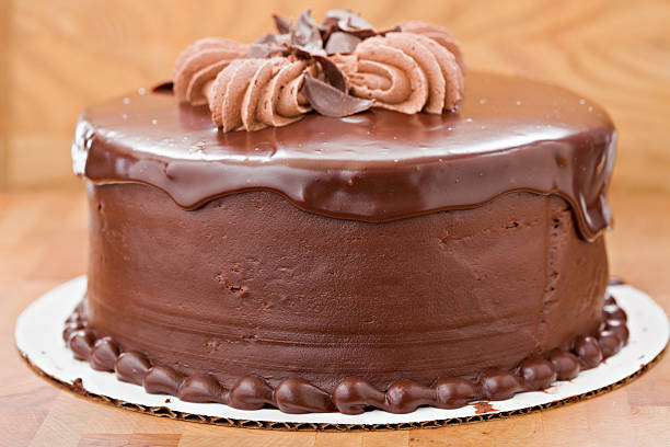 whole chocolate fudge cake - big cake stock photos and pictures