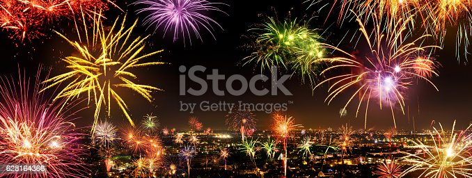 istock Whole city celebrating the New Year with fireworks 628164366